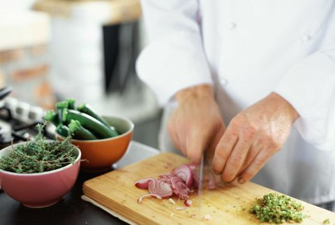 restaurant chef chopping vegetables