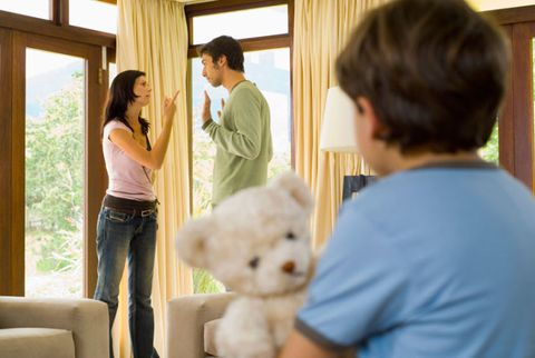 parents fighting near a child and a teddy bear