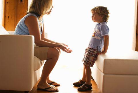 woman talking to small boy