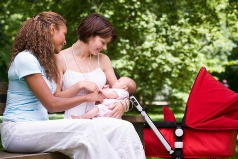 mother with a baby carriage and a friend