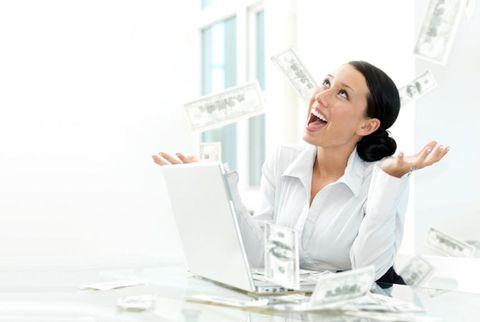 money falling on a businesswoman