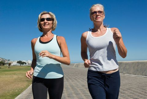 two women walking outdoors