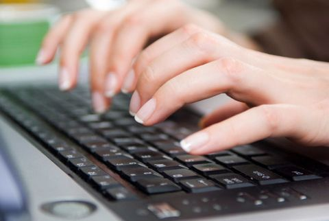 woman typing keyboard
