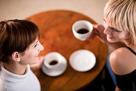 women friends talking over coffee
