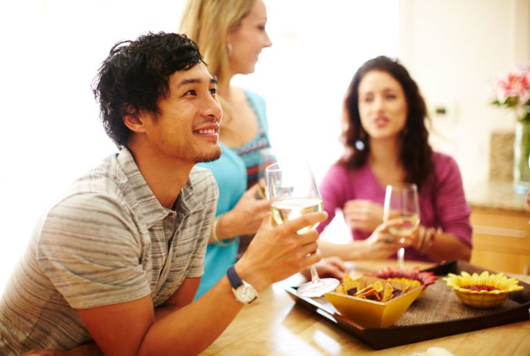 guests drinking wine at a party
