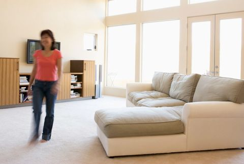 woman walking in her living room