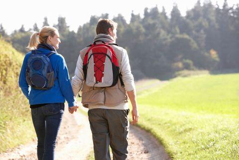 couple walking with backpacks on
