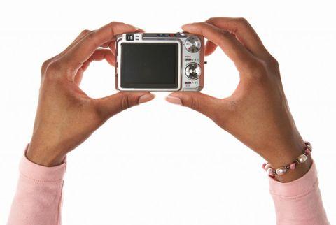 woman holding a digital camera