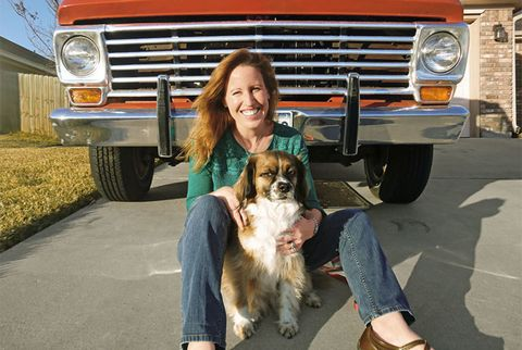 woman with dog by car