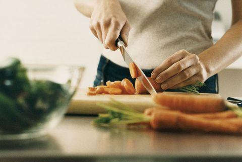 woman chopping carrots