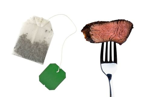 tea bag and a piece of steak on a fork