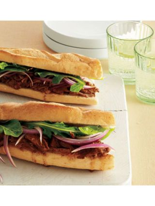"""<p>Bite into this ultimate palate-satisfying sandwich. Perfect as a hearty lunch or a filling, group dish for crowds, guest won't be able to stop talking about this tasty recipe. </p> <p><a href=""""http://www.womansday.com/recipefinder/lamb-sandwiches-with-red-onion-and-arugula-recipe?click=rec_"""" target=""""_self""""><strong>Get the recipe</strong></a></p>"""