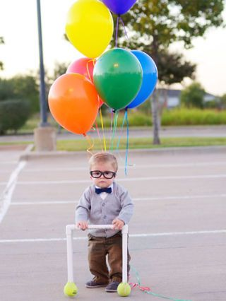 """<p>Seriously, you can't make a costume any more simple—not to mention adorable—than this. Give your kid some balloons, glasses, and a PVC pipe walker and you're good to go.</p> <p><strong>See more photos at <a href=""""http://www.auburnsoulphotography.com/2014/09/up-baby.html"""">Auburn Soul</a>.</strong></p>"""