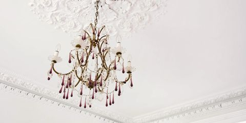 """<p>Want to add a touch of elegance to your dining room but don't know where to begin? We've got everything you need to get started.</p> <p><strong>1. Pick the right style.</strong> Look to your furniture for cues. Ornate upholstered chairs? Consider a crystal chandelier. Farmhouse table? Try a fixture with a rustic finish.</p> <p><strong>2. Determine the right scale.</strong> A too-big chandelier will make a small room look even smaller, while a tiny fixture will disappear in a big room. Add your room's length and width in feet and get a fixture whose width is the same number of inches(a 12' x 16' room gets a 28"""" light), advises Jeff Dross of Kichler Lighting. Another useful guideline: A chandelier should be at least half the table width (so it won't look puny). If your ceiling are higher than the standard 8 feet, go for a taller fixture; if your dining area is part of a great room, go even larger.</p> <p><strong>3. Get the right wattage.</strong> Since most of us use our dining rooms for more than just dining (paying bills, quilting), make sure that your bulbs provide enough task lighting. Multiply the length and width of the room in feet, then multiply that by 1.5 to get all the wattage you need (a 12' x 16' room needs 288 watts, so eight 40-watt bulbs will do). A dimmer lets you lower the light to a cozy level for entertaining.</p> <p><strong>4. Hang at the right height.</strong> The bottom of a chandelier should hit about 30"""" (36"""" at most) above the tabletop. That brings the light close enough for tasks, clears the view for conversation and avoids unflattering shadows. Tip: Swap regular blubs for pink ones when entertaining––the rosy glow is ultra-flattering. And be sure you leave 30 inches between the chandelier and tabletop.</p>"""