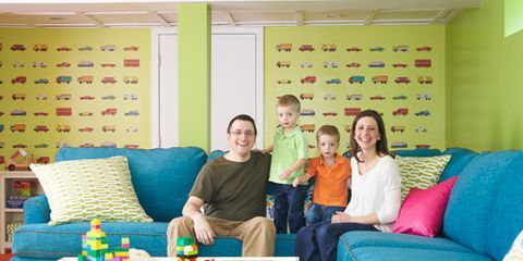 """<p>Until the economy picks up, the too-small house that was Beth and Mike Hopkins's starter home will be their stay-put home. So <em>Woman's Day</em> sent designer Annie Selke to transform an unused basement into a playroom the whole family can spread out in.</p> <p>""""It's impossible not to feel excited when you come into the new space,"""" says Beth, here with husband Mike, and twin sons Aiden (<em>left</em>) and Christopher (<em>right</em>).</p> <p>Five years ago, Beth and Mike Hopkins were thrilled to find an affordable small house in Suffield, CT. """"We were both born and raised in New England and loved the charm of the area,"""" says Beth. """"But the house was over 40 years old and had never been updated. Our plan was to put a lot of work into it and then trade up to something bigger."""" They wasted no time getting started: """"We closed on the house the day before my wedding shower, and a few hours later, Mike and I had already started ripping up linoleum and gutting a bathroom.""""</p> <p>Over the next two years, the couple added closets, removed walls, put down a walkway and rebuilt a porch. After twins Aiden and Christopher were born in February 2009, Beth quit her job. At around the same time, Mike lost his. He quickly found work selling life insurance, but because his salary is entirely commission-based, it's wildly unpredictable. """"We went from living pretty comfortably to worrying that we were going to lose our home,"""" says Beth.</p> <p><strong>Crowded House</strong></p> <p>Meanwhile, the boys—now rambunctious 3-year-olds—were growing and, well, being boys. """"No matter how much I tidied up, there were always toys strewn everywhere,"""" says Beth. """"My husband joked that it looked like we ran a day-care center."""" The Hopkinses had definitely outgrown their ranch house, but there was no room in the budget for turning the huge unfinished basement into a family room. """"We're big do-it-yourselfers, but this was just too large a project for us,"""" Beth admits. So when she saw a call for m"""
