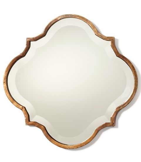"""Try the petite 13¾"""" x 13½"""" <b>Crest Mirror</b> solo, in a pair flanking a window or as a quartet above the sofa. <i>$69; <a href=""""http://www.ballarddesigns.com/crest-mirror/246164"""">BallardDesigns.com</a></i>"""