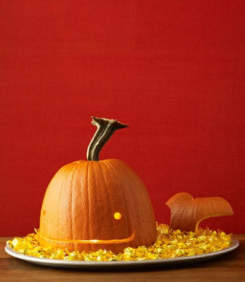<p>A tall pumpkin works best for this guy: Slice off the bottom third and carve the tail out of it. Cut a simple, smiley face in the larger section. Pop off the stem and attach it, upside-down, as a spout.</p> <p><strong>Materials</strong></p> <p>Tall pumpkin with long stem</p> <p>Knife or pumpkin carver</p> <p>Washable marker</p> <p>Vegetable peeler</p> <p>Damp cloth</p> <p>3 to 5 toothpicks, snapped in half</p> <p>Tray</p> <p>Candy</p> <p><strong>Directions</strong></p> <p>1 Slice off the bottom third of the pumpkin and scoop out the seeds.</p> <p>2 Carefully pop off stem, using a knife if necessary. Set aside.</p> <p>3 Draw eyes and mouth on the pumpkins with the marker and carve out. Wipe off any remaining marker with a damp cloth.</p> <p>4 Using the discarded rind from the bottom of the pumpkin, draw a tail shape that follows the curve of the bottom of the pumpkin. Carve out and wipe off any remaining marker.</p> <p>5 Cut a small triangle from the remaining rind. Press a half-toothpick to the underside of the tail, then press in the triangle (this will support it like a tripod).</p> <p>6 Place the whale head and tail on a tray. Cover the tray with candy.</p> <p>7 Reattach the pumpkin stem upside down to the top of the whale head using a half-toothpick.</p>