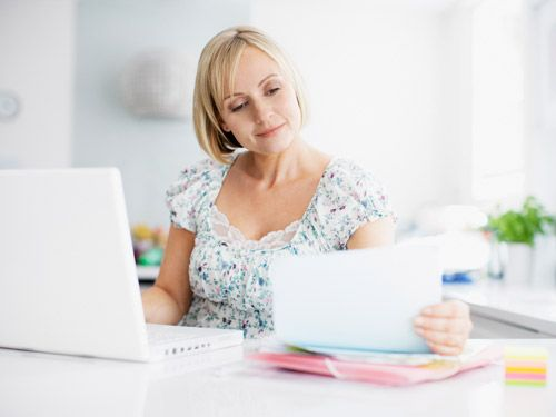 woman checking computer