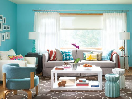 "<p>After losing her job, reader Francesca Mingione needed some help bouncing back. To the rescue: the <em>Woman's Day </em>makeover team, who transformed her living room into a cheery space that matches her hopeful new outlook.</p> <p>""I was nervous about the new paint color,"" Mingione says. ""But it's so cheerful, I can't help but be happy when I'm in there.""</p> <p> </p> <p><strong>How to create a welcoming space</strong></p> <p>Organize a ""campfire circle.""</p> <p>Arrange seating in groups around a single element like a coffee table or ottoman to encourage conversation. <em>Mitchell Gold + Bob Williams Cynthia Sofa, $3,480 as shown; <a href=""http://www.mgbwhome.com/CYNTHIA-COLLECTION-P9662.aspx"" target=""_blank"">mgbwhome.com</a>.</em> <em>Home Decorators Parsons Table, $229; <a href=""http://www.homedecorators.com/detail.php?parentid=05504&search=05504&suggest=11&sItem=05506"" target=""_blank"">homedecorators.com</a>. Ballard Designs Lotus Garden Seats, $159 each; <a href=""http://www.ballarddesigns.com/lotus-garden-seat/194171"" target=""_blank"">ballarddesigns.com</a>. West Elm Parsons Side Table, $199; <a href=""http://www.westelm.com/products/parsons-end-table-g056/"" target=""_blank"">westelm.com</a>.</em></p> <p> </p> <p>Have fun with color.</p> <p>Upbeat paint (in bright blue, for example) and complementary accents such as pillows, lamps and throws add whimsy. <em>Benjamin Moore Pool Blue 2052-50 Paint, from $36; <a href=""http://store.benjaminmoore.com/storefront/product-view.ep;jsessionid=TMMDPDTJJTnynwHV5HGPpTNphy1S1LwY0vVdTJwpvJpQzJ1Z7w2K!-1507095700?pID=100947"" target=""_blank"">benjaminmoore.com</a>.</em> <em>The Shade Store Solar Shades, from $152 each; <a href=""http://www.theshadestore.com/landing/roller-solar"" target=""_blank"">theshadestore.com</a>. Country Curtains Hemstitch Rod Pocket Curtains, from $39.50; <a href=""http://www.countrycurtains.com/product/0101r028+hemstitch+rod+pocket+curtains.do"" target=""_blank"">countrycurtains.com</a>. Becket Nickel Rod Set, from $29.50; <a href=""http://www.countrycurtains.com/product/300+rods+and+hardware/301+new+arrivals/03039003b+becket+adjustable+rod+set.do"" target=""_blank"">countrycurtains.com</a>. Becket Chess Finials, $29.50; <a href=""http://www.countrycurtains.com/product/300+rods+and+hardware/301+new+arrivals/03069003c+becket+chess+finials.do?search=basic&keyword=chess+finials&sortby=bestSellers&page=1&filterby"" target=""_blank"">countrycurtains.com</a>. C. Wonder Zebra Pillow, $48; <a href=""http://www.cwonder.com/home-decor-1/decorative-accents/pillows-bedding/embroidered-zebra-pillow-cover-3/"" target=""_blank"">cwonder.com</a>. Henry Road Leaves Pillow, $90; <a href=""http://henryroad.com/p-20flgr-tapu.html"" target=""_blank"">henryroad.com</a>. Henry Road Gloria Pillow, $75; <a href=""http://henryroad.com/p-1418gl-yel.html"" target=""_blank"">henryroad.com</a>. Home Goods Graphic Pillow, $17; <a href=""http://www.homegoods.com/"" target=""_blank"">homegoods.com</a> for stores. Thomas Paul Mod Mex Pillow, $80; in stores. C. Wonder Throw, $98; <a href=""http://www.cwonder.com/wool-throw-1/"" target=""_blank"">cwonder.com</a>. Wayfair Dimond Lighting Stanton Lamp, $215; <a href=""http://www.wayfair.com/Dimond-Lighting-Stanton-Floor-Lamp-in-Dunbrook-With-Glass-Tray-D1403D-DIL1101.html"" target=""_blank"">wayfair.com</a>.</em></p> <p> </p> <p>Make the room livable.</p> <p>When you're worried about stains, guests won't feel at ease. Outfit high-traffic areas with dark rugs to hide tracked-in spots and furniture with removable, washable slipcovers. <em>Garnet Hill Bogart Rug, $628; <a href=""http://www.garnethill.com/bogart-flat-weave-wool-rug/kids-rooms/rugs/17031"" target=""_blank"">garnethill.com</a>.</em></p> <p> </p>"