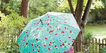 """<p><em>Project excerpted from One-Yard Wonders: Cottons, Knits, Voiles, Corduroy, Fleeve, Flannel, Home Dec, Oilcloth, Wool, and Beyond.</em></p> <p>Make a """"perfect storm"""" with your favorite coated fabric and an old umbrella! As long as the frame is in great shape, you can give that worn, torn old umbrella a new life with this easy project. You'll never let a little rip keep you indoors again!</p> <p>Materials <br />*1 yard of 54/55"""" oilcloth or other laminated fabric <br />*1 spool of coordinating thread <br />*Umbrella, 36"""" in diameter or smaller (make sure the ferrule piece at the top can be unscrewed and removed easily) <br />*Posterboard or other large-format paper or interfacing for making a pattern <br />*3"""" circle template <br />*Beeswax (optional)</p> <p><strong><em>Finished dimension</em>s</strong> — depending on umbrella; no wider than 36"""" wide when opened <br /><em><strong>Seam allowance</strong></em> — ¼"""" unless otherwise specified</p>"""