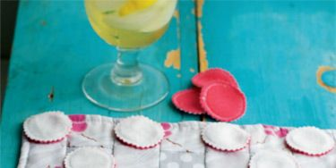 """<p><em>Project excerpted from Sew What You Love: The Easiest, Prettiest Projects ever. </em></p> <p>Finding something for kids to do on long trips is always a problem. This is a good old-fashioned solution that encourages interaction and will keep them engaged for a little while. Hopefully it will also save you from hearing """"Are we there yet?"""" one more time. Once you arrive, use it for quiet evenings in the cabin or on picnics at the beach. The checkers are reversible, and the checkerboard serves as a storage bag. For a cute no-sew alternative, use big buttons for the checkers. It all rolls up and ties to fifi t neatly into your luggage.</p>"""