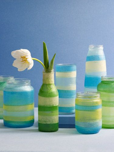 "<p>Repurpose your recyclables as cheerful vases for the first blossoms of spring.</p> <p>Materials:</p> <p>     · Glass jar, cleaned, with label removed</p> <p>     · Tape measure</p> <p>     · Scissors</p> <p>     · 2 or 3 colors of tissue paper</p> <p>     · Mod Podge decoupage glue</p> <p>Instructions:</p> <p><strong>1. </strong>Measure the circumference of the jar. Cut several ½""- to 1""-wide strips of each color of paper to this length.</p> <p><strong>2. </strong>Apply Mod Podge around the bottom 1"" of the jar and lay a strip of paper over it, gently smoothing out any wrinkles or bubbles. Continue in this fashion, overlapping paper edges slightly, until the jar is covered.</p> <p><strong>3. </strong>Coat the covered jar with 1 or 2 layers of Mod Podge, following package directions. Let dry.</p>"