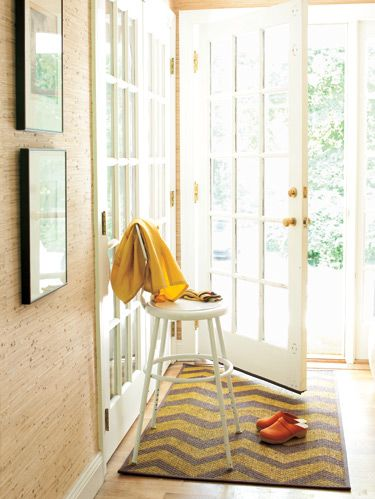 """<p>From crisp stripes to artsy (but easy!) detailing, check out five pretty ideas for transforming overlooked areas, like floors, stairs and rugs.</p><p>A bold pattern in the entryway––think of-the-moment zigzags or broad blocks of color––sets a vibrant tone for your home. It's also a chance to try a style before making a bigger commitment, like painting your entire floor. Your basic tools: acrylic fabric paint from the craft store and a bristly paintbrush to work it into the weave.</p><p>*For detailed directions for the projects shown in this slideshow, go to <a href=""""http://www.womansday.com/floor"""">WomansDay.com/Floor</a>.</p>"""