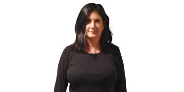"""<p>""""My body shape changed. Now what?"""" asks Sarah Greenstein of Merrick, NY. After she quit smoking, excess weight crept up suddenly. Now most of what's in her closet is just a little too snug. She has defaulted to a uniform of jeans and a black T-shirt, hoping to disguise the 10 pounds that have settled around her midsection. In fact, this let-it-all-hang-out combo only accentuates her tummy. What this busy mother needs: figure-friendly pieces that are pulled-together but fuss-free.</p> <p> </p>"""