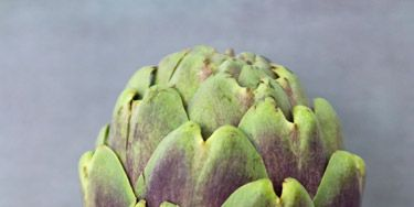 <p>Eat your way to their tasty, tender heart, or toss canned or frozen artichokes into salads and pastas. Here's how to enjoy every bite.</p> <p>→ Fresh: Artichokes should be firm and heavy for their size, with the outer leaves just beginning to open. To store, sprinkle with water and refrigerate in an airtight bag for up to a week.</p> <p>→ Canned: Artichoke hearts in cans are usually packed in brine. Their soft texture makes them ideal for creamy dips and casseroles. Rinse and pat dry before using to remove any excess salt.</p> <p>→ Marinated: Hearts marinated in oil and dried herbs (like oregano and thyme) have a strong flavor. Use them in a recipe only if specifically called for, as they can overpower a dish. They're delicious tossed into salads, used as a pizza topping or chopped and added to a sandwich.</p> <p>→ Frozen: Artichoke hearts from the freezer case are the healthiest option after fresh as they have no added calories or fat. They're only partially cooked, so they keep their texture better than canned or jarred when they're roasted or sautéed. Thaw and pat dry before using to avoid ending up with too much liquid in your dish.</p>