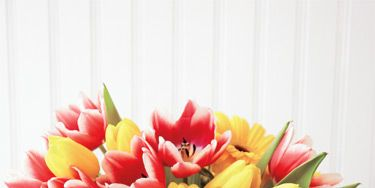 <p>Flowers are the classic Mother's Day gift, but they can cost you big if you order from a florist. To spend less without losing the loveliness, consider buying the basics from a grocery store instead. Just how much will you save? Click through to find out, plus learn what other blooms look best with these pretty petals.</p>