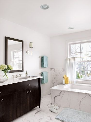 "<p>Designer Tracey Butler of New Jersey's <a href=""http://www.bhomeinteriors.net/"" target=""_blank"">b.home Interior Design</a> weaves a timeless tale in a spacious South Jersey bathroom. To set the scene, she first worked on what stone to use. The right marble can tell a room's story: The gray and gold veins of Calcutta Gold, seen on the walls, floor, counters and tub surround, infuse a traditional stone with contemporary appeal.</p>"