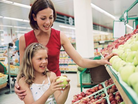 "<p>Feeding a family is never easy. Putting the right foods in front of your brood takes time, money and thoughtfulness. But what exactly does <em>right</em> mean? It's tough to know, given all the competing information about organic vs. nonorganic foods. ""Buy most things organic if money's no object; but for most people, this isn't the case,"" says Bridget Swinney MS, RD, LD, author of <em><a href=""http://www.amazon.com/Eating-Expectantly-Practical-Prenatal-Nutrition/dp/0671318209"" target=""_blank"">Eating Expectantly</a></em>, <em><a href=""http://www.amazon.com/Baby-Bites-Bridget-Swinney/dp/0684040034/ref=sr_1_1?s=books&ie=UTF8&qid=1335818134&sr=1-1"" target=""_blank"">Baby Bites</a></em> and <em><a href=""http://www.amazon.com/Healthy-Food-For-Kids-Nutritional/dp/B005M4UBZS/ref=sr_1_1?s=books&ie=UTF8&qid=1335818145&sr=1-1"" target=""_blank"">Healthy Food for Healthy Kids</a></em>. ""I suggest families look at what their children eat on a regular basis and then look online to see how those foods rank in number of pesticides."" Then, buy organic versions of the favorite foods that are high in pesticides and standard items for the rest. Or take a look at this cheat sheet from nutrition experts on which kid picks are worth buying organic—and which aren't.</p>"