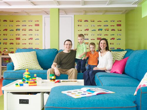 "<p>Until the economy picks up, the too-small house that was Beth and Mike Hopkins's starter home will be their stay-put home. So <em>Woman's Day</em> sent designer Annie Selke to transform an unused basement into a playroom the whole family can spread out in.</p> <p>""It's impossible not to feel excited when you come into the new space,"" says Beth, here with husband Mike, and twin sons Aiden (<em>left</em>) and Christopher (<em>right</em>).</p> <p>Five years ago, Beth and Mike Hopkins were thrilled to find an affordable small house in Suffield, CT. ""We were both born and raised in New England and loved the charm of the area,"" says Beth. ""But the house was over 40 years old and had never been updated. Our plan was to put a lot of work into it and then trade up to something bigger."" They wasted no time getting started: ""We closed on the house the day before my wedding shower, and a few hours later, Mike and I had already started ripping up linoleum and gutting a bathroom.""</p> <p>Over the next two years, the couple added closets, removed walls, put down a walkway and rebuilt a porch. After twins Aiden and Christopher were born in February 2009, Beth quit her job. At around the same time, Mike lost his. He quickly found work selling life insurance, but because his salary is entirely commission-based, it's wildly unpredictable. ""We went from living pretty comfortably to worrying that we were going to lose our home,"" says Beth.</p> <p><strong>Crowded House</strong></p> <p>Meanwhile, the boys—now rambunctious 3-year-olds—were growing and, well, being boys. ""No matter how much I tidied up, there were always toys strewn everywhere,"" says Beth. ""My husband joked that it looked like we ran a day-care center."" The Hopkinses had definitely outgrown their ranch house, but there was no room in the budget for turning the huge unfinished basement into a family room. ""We're big do-it-yourselfers, but this was just too large a project for us,"" Beth admits. So when she saw a call for makeover candidates in <em>Woman's Day,</em> she wrote in.</p> <p><strong>Problem Solved!</strong></p> <p>Enter Massachusetts-based designer Annie Selke, author of <em><a href=""http://www.amazon.fr/Fresh-American-Spaces-Romantic-Exuberant/dp/0307716066/ref=sr_1_1?ie=UTF8&qid=1336418171&sr=8-1"" target=""_blank"">Fresh American Spaces</a>,</em> who added vibrancy to the new playroom with colorful furniture and accessories and bright paint. Her biggest challenge was to strike a balance between fun and functionality—and the result was a big hit with the whole family. ""Seeing the boys get so excited to go down and play in their own little world has been wonderful for Mike and me,"" says Beth. ""After everything we've been through over the past few years, we needed this. It was a real blessing for us.""</p> <p>""I wanted to make this room bright and fun for the kids but practical for the adults,"" says Annie Selke (<em>slide 7</em>, with Beth).</p>"