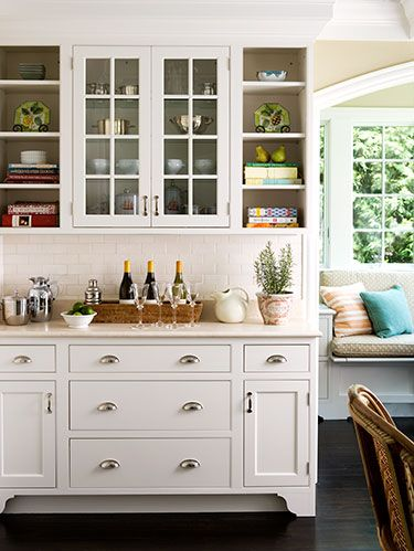 <p>The kitchen is one of the most-used rooms in your house, so why not make it beautiful? No, a big-budget renovation isn't necessary. After all, it's the little things that count! Read on and keep clicking for inexpensive ideas to add elegant touches to your kitchen.</p><p><strong><em>REMOVE A COUPLE OF CABINET DOORS</em></strong></p><p>Seeing shelves instead of a solid front will make the room look bigger (fill in screw holes with wood putty and repaint the interior). Create a balanced focal point with units that flank a large object (the stove, sink or a pair of glass-front doors, <em>as above</em>). Then fill them with your kitchen's best-looking contents, like rows of glasses, cookbooks or stacks of colorful plates.</p>