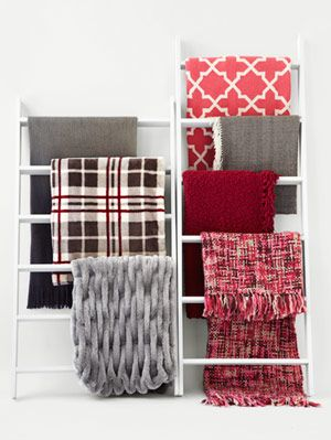 "<p>Your winter just got cozier! These chill-chasing throws are perfect for snoozing or for curling up with a good book. If you like to pull a blanket right up to your nose while you read on the couch, make sure you unfold it at the store or check the dimensions: It should be at least as long as you are tall. Another good tip? Warm up your home decor with Home Editor Ayn-Monique Klahre's tip. ""When I get bored with my cream-hued sofa, I drape a throw over the back for a swath of color.""</p> <p> </p> <p> </p>"