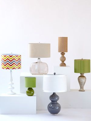 """<p>Whether you need to brighten up your bedroom or lighten up your living room, these table lamps will do the trick. With their chic designs and colorful patterns, these stylish selections are sure to be star pieces in any room. Choosing a lamp for reading? Make sure the shade directs light onto your book and not into your eyes. Sit next to the table where the lamp will go and measure from the tabletop to chin-height—that's where the bottom of the shade should hit. If you're a TV fan before bedtime, follow home editor Ayn-Monique Khlare's tip: <em>""""To go from bright light to a TV-viewing glow, I use a plug-in dimmer (about $10 at <a href=""""http://www.amazon.com/Westek-6004-3-Level-Plug-In-Dimmer/dp/B00004XS8Y/ref=sr_1_5?ie=UTF8&qid=1357666134&sr=8-5&keywords=plug-in+dimmer"""" target=""""_blank"""">Amazon.com</a>).""""</em></p>"""