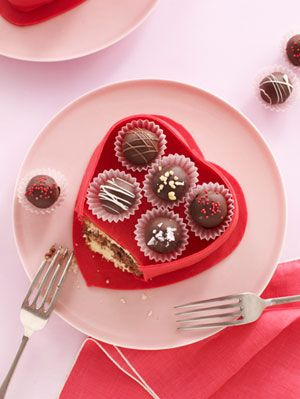 <p>Sweeten up Valentine's Day with a truffle box cake. Not only are palate-pleasing truffles part of this pastry, but the box is also edible! Click through to learn how to make the round treat and how to create the life-like candy box.</p>