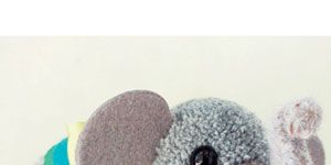 <p><em>Project excerpted from Adventures in Pompom Land: 25 Cute Projects Made from Handmade Pompoms</em><br /><br />They say Elephants have incredible memories—this little fellow's bright eyes and friendly expression make him a creature you'll never forget.</p> <p>Materials</p> <p>• Basic Pompom Toolbox<br /> • 100% wool yarn: gray<br /> • 100% wool felt: gray, and<br />two colors of your choice<br /> • 100% wool roving: gray<br />• 4-inch (10.2 cm) gray pipe cleaner<br />• Needle felting supplies<br /> • 2 black glass eyes, 10 or 12 mm<br />• Template: ears <br />• Wire cutters<br />• 12-inch (30.5 cm) length of wooden dowel, 5 mm in diameter<br />• Scallop-edge scissors or zigzag pinking shears (optional)<br /> • Micro hole punch (optional)<br />• Ribbon</p> <p>FINISHED MEASUREMENTS: 53⁄4 inches (14.6 cm) tall at the top of the head</p>