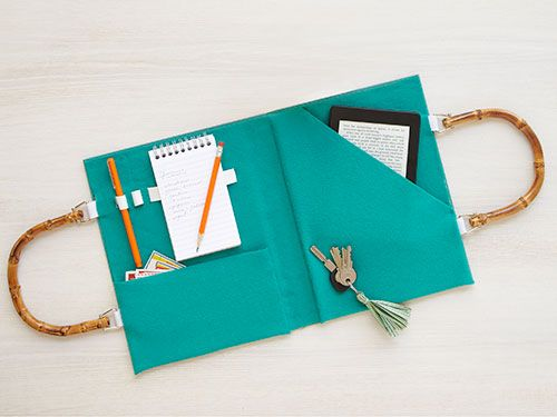"""<p><strong>Shaunte Wadley, Lehi, UT</strong></p><p>For her idea, Shaunte removed the book pages, then added purse handles, felt pockets and elastic loops to hold all the essentials when on the go.</p><p>Old book</p><p>Craft knife or razor blade</p><p>Pencil</p><p>Ruler</p><p>Purse handles</p><p>4 2-inches pieces of ½""""-wide nylon strapping or grosgrain ribbon</p><p>Hot glue gun and glue sticks</p><p>Felt</p><p>Scissors</p><p>½"""" wide elastic</p><p>Craft glue</p>"""