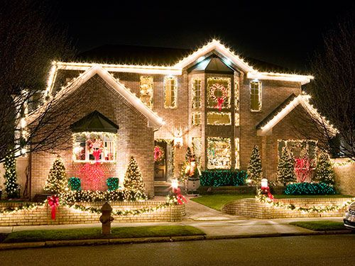 """<p>From the tree lights to your outdoor <a href=""""http://www.womansday.com/home/holiday-decorating-ideas/quick-christmas-crafts"""" target=""""_self"""">holiday decorations</a>, all that festive fun is certainly easy on the eyes, but it can do a number on your budget. Light up the right way to give yourself the gift of an afforable electric bill. Keep reading for smart strategies even Santa would approve. </p>"""
