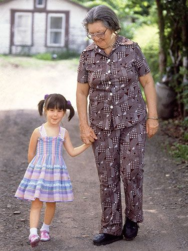"<p class=""p1""><em>In 1986, </em>Woman's Day<em> ran an article about Marjorie Hotchkiss (left), a 70-year-old single woman in upstate New York, who adopted a baby girl (Juanita [right] was 5 when our article appeared). <a href=""http://www.womansday.com/cm/womansday/data/GoldenAgedMom.pdf"" target=""_self"">Click here</a></em> <em><a href=""http://www.womansday.com/cm/womansday/data/GoldenAgedMom.pdf"" target=""_self"">to read it</a>. Here is the rest of her story.</em></p> <p class=""p1"">No child should go through what I did—which is why I turned my own tough times into a career helping others.</p> <p class=""p1"">When I was little, I knew my life wasn't like other kids'. My mom was as old as their grandmas, for one thing, and didn't drive, so friends would take me to doctor's appointments and dance class. But she was warm and wonderful, always singing show tunes and reading me poetry. It was her lifelong dream to have a child, and I felt very loved.</p> <p class=""p1"">Then, in 1990, when I was 8 and she was 78, she was <a href=""http://www.womansday.com/health-fitness/5-breast-cancer-bloggers-share-their-stories-112202"" target=""_self""><span class=""s1"">diagnosed with cancer</span></a>. I was terrified that she'd die—sometimes I cried myself to sleep with worry. The more time she spent weak and in bed and the less she could pay attention to me, the more scared I became, and I began to act out—badly. By the time my mom's cancer was in remission a year later, I had failed fourth grade and I was an angry, sullen child.</p> <p class=""p1"">Things got even worse when she broke her hip, and I started to tangle with her home health aide, who had a lot of control over her and didn't want me around. It was tense, so I avoided the house, running wild with my friends. By age 13, I stayed out smoking and drinking until 3 A.M. I missed so much school that I had no idea what was going on. I kept hoping someone would notice, but no one seemed to.</p> <p class=""p1"">Then, on a day that I happened to be at school, some scary people came and told me I wasn't going home. My mom couldn't handle me and she asked that I be placed in foster care. It was a nightmare. Outwardly, I acted like I didn't care. Inwardly, though, I was in tremendous pain and shock. I loved my mom and I knew deep down she loved me. I thought, <em>I am such a bad daughter!</em> I didn't think I was worthy of her—or anyone's—love.</p> <p class=""p1"">I bounced around among several families and group homes, and ran away each time, usually with another girl. Mostly we lived on the streets, and ended up in four different states at various times, surviving by begging for money or a place to stay. We'd tell people that we'd been separated from our family. They'd look at me, with my cute freckles and smile, and they'd help, believing my parents were on their way. But they weren't.</p> <p class=""p1"">I was lucky I wasn't raped, like my friend was. When the police finally picked me up as a runaway, I was in New York City. I was sentenced to juvenile detention. I didn't show it, but frankly, I was relieved.</p> <p class=""p1"">At the center, I played along with the counseling program. I didn't have much faith in it, but I decided that as long as I was locked up, I might as well get something from it—plus, the quickest way out was to be on my best behavior. A counselor helped me realize that I wasn't a bad kid, I was just hurt and let down. I'd been going on adrenaline for so long that I was numb, but with his help, I saw how scared I was of being abandoned. After a few months, I started to believe that I really <em>could</em> change, that I had a choice: I could stop blaming myself for being so hard to manage and others for not taking care of me, and I could have a future. I began to excel at my schoolwork, and did so well that after a year, at 16, I was released to distant family friends.</p>"