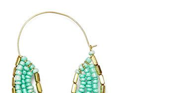 <p><span>You'll forget you're wearing these surprisingly light weight Gold Beaded Hoop Earrings ($20; ZadRetail.com).</span></p>