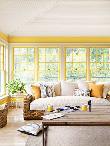<p>Walls of windows are pretty, but they leave little room to hang decorations. For a twist, paint the wood between panes the same color as the walls, creating frames for what's outside. No need to tape off each square—use a razor to scrape off excess dried paint.</p>