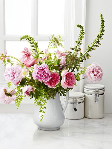 <p>1. Start with Variety</p> <p>For a more interesting and colorful bouquet, select some flowers that have already bloomed and others that are just budding.</p> <p>2.  Prep Smart</p> <p>Clear a table or counter and group your flowers in loose piles so you can quickly pick up separate stems. Fill a vase two-thirds full with cool water.</p> <p>3. Cut Right</p> <p>Using sharp scissors, trim stems as you go to avoid wilting (cut at a 45-degree angle so they get more water). To prevent mold, strip leaves that will sit in the water.</p> <p>4. Go in Order</p> <p>Add greenery to the vase first to create a base for your arrangement; allow some to drape over the sides. Layer in larger blossoms before filling in with smaller buds.</p> <p>5. Forget Perfect Symmetry</p> <p>Aim for off-center harmony instead: Pair two of your bigger flowers on one side of the vase and add a single blossom on the opposite side. Repeat as needed.</p> <p>6. Zoom Out</p> <p>Step back and look at your bouquet. Do you like the shape? The color? Balance any overly green patches with sparser flowers or fill in holes with greenery.</p>