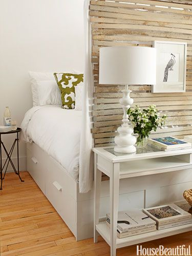 """<p>Lathe walls enclose the sleeping area in a <a href=""""http://www.housebeautiful.com/kitchens/dream/studio-apartment-kitchen-0712"""" target=""""_blank"""">400-square-foot Brooklyn apartment</a>. """"Inside, it's hung with white curtains,"""" Lyndsay Caleo of The Brooklyn Home Company says. """"It's incredibly cozy, like you're in a nest, a cocoon, but it's still light and airy."""" The Brimnes bed from Ikea has drawers underneath, for more storage. """"We decided to define a sleeping area, because we felt people needed a private space,"""" says design partner Fitzhugh Karol.</p>"""
