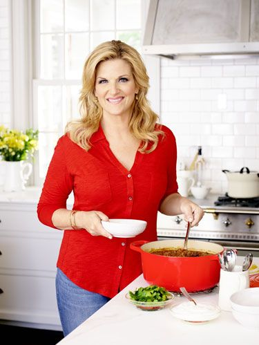 "<p>As with many families in America, getting everyone to the dinner table is a near-impossible task for Trisha Yearwood. ""First of all, we're musicians, so there's no 'routine,'"" she admits with a laugh. The <a href=""http://www.womansday.com/sex-relationships/family/beat-back-to-school-syndrome-109596"" target=""_self"">start of the school year</a> is always the craziest for her and her husband of nine years, Garth Brooks, and his three daughters, Taylor, 22, August, 20, and Allie, 18, from his previous marriage. On top of Trisha's multiple career demands—Grammy-winning country artist, bestselling cookbook author, Emmy-winning host of <em>Trisha's Southern Kitchen </em>on the Food Network—she has to juggle Garth's and the girls' busy schedules.</p> <p>""All those years of three girls and their activities? Even with only one still at home, there are a million things going on every night,"" Trisha says. Which is how she became so adept at the shortcuts that make getting food on the table faster and easier.</p> <p>Trisha also knows that to bring everyone to the table, sometimes she has to pull out the big guns and prepare the girls' favorite meal. ""Taylor and August are in college now, but they live nearby, and if I send out a text that says, 'Hey, it's veggie night,' they'll show up. They know it means I'm roasting all their favorite vegetables and probably serving a meat loaf, too,"" Trisha says. (Her shortcut tip: Peel and chop <a href=""http://www.womansday.com/food-recipes/10-root-vegetable-side-dishes-soups"" target=""_self"">root vegetables</a> the day before and store them in the fridge in an airtight container. The next day, pour them onto a baking sheet, drizzle with olive oil, top with a little salt and pepper, and put them in the oven.)</p> <p>""I'm always fighting hard to make sure family meals don't get lost in the shuffle, because cooking for the kids means I have one more dinner at home with them,"" says Trisha. ""These girls are growing up and who knows where we're all going to land, so we need to make that time now. Having all of us under one roof? That's like heaven.""</p> <p><strong>See also: <a href=""http://www.womansday.com/food-recipes/7-affordable-family-dinners-119865"" target=""_self"">7 Affordable Family Dinners</a></strong></p> <p> </p>"