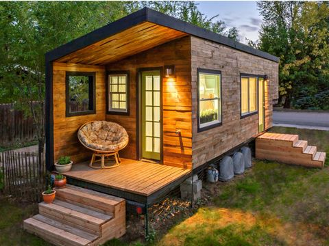 """<p dir=""""ltr""""><span>This 196-square-foot house near Boise, Idaho, is home to Macy Miller, her partner James, their daughter Hazel, and their Great Dane, Denver. A 27-year-old architect, Macy designed the home from scratch and built it on a 24-foot flatbed with help from friends and family. Clad in siding made of recycled pallet wood, the minimalist home is flooded with light and feels spacious despite its size. Hidden storage under the bed, above the pantry, and behind the fridge are contrasted with open shelving in the kitchen to make the space feel bigger. In total, Macy spent about $11,000 on her tiny house and is now able to live rent- and mortgage-free.</span></p> <p dir=""""ltr""""><a href=""""http://minimotives.com/pro-photos/"""" target=""""_blank"""">Find out more about Macy's tiny house</a>.</p> <p> </p>"""