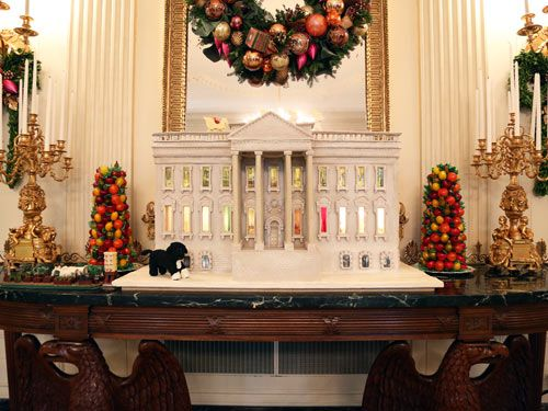 <p>No, that's not <em>the </em>White House. But it is the White House Gingerbread House—which lives inside <em>the </em>White House. And when WomansDay.com was invited to take a tour of the presidential home for the holidays, we couldn't refuse!</p> <p>Pastry chefs and even electricians work tirelessly on this mini house in the days leading up to the holiday season each year. The 2012 version incorporates more than 175 pounds of gingerbread and modified gingerbread and more than 50 pounds of chocolate. And thanks to a mix of wheat, rye and white-flour gingerbread (and the White House pastry chef comparing pieces of bread to an unpainted part of <em>the</em> White House), the creation's color matches the original sandstone of the residence before it was painted white in 1798. For even more accuracy, there's a gum paste and marzipan version of the First Lady's garden and a Bo figure, to represent the Obama's beloved dog, made out of chocolate. Click through to see the other awe-inspiring Christmas decorations inside the White House.</p>