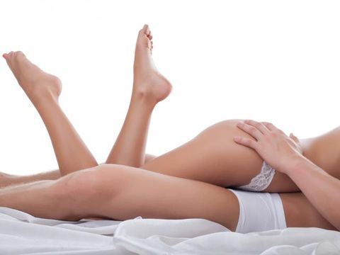 Skin, Comfort, Human leg, Sitting, Knee, Undergarment, Beauty, Foot, Sunlight, Thigh,
