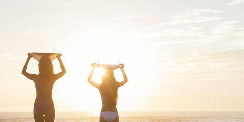 Human body, Standing, People in nature, Waist, Sunlight, Summer, Swimsuit top, Beach, Vacation, Undergarment,